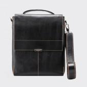 Деловая мужская кожаная сумка-планшет через плечо.  Фото.